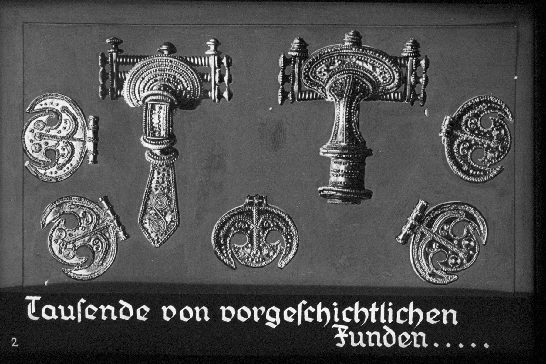 """2nd Nazi propaganda slide of a Hitler Youth educational presentation entitled """"German Achievements in the East"""" (G 2)  Tausende von vorgeschichtlichen Funden... // Thousands of prehistoric finds ..."""