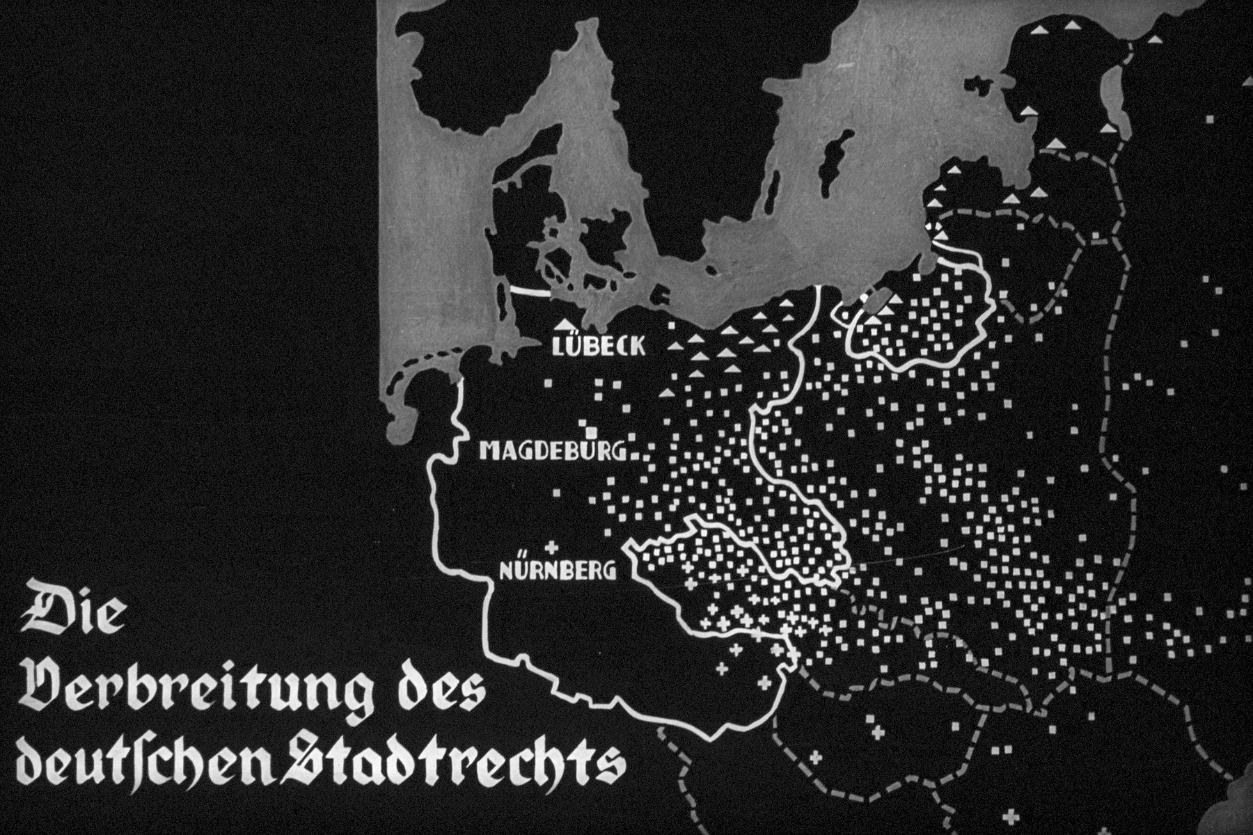 "18th Nazi propaganda slide of a Hitler Youth educational presentation entitled ""German Achievements in the East"" (G 2)  Die Verbreitung des deutschen Stadtrechts // The spread German town law."