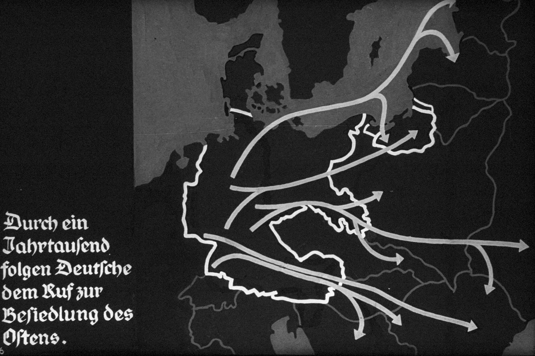 "6th Nazi propaganda slide of a Hitler Youth educational presentation entitled ""German Achievements in the East"" (G 2)  Durch ein Jahrtausend folgen Deutsch dem Ruf zur Besiedlung des Ostens. // For a thousand of years follow the German colonization of the East."