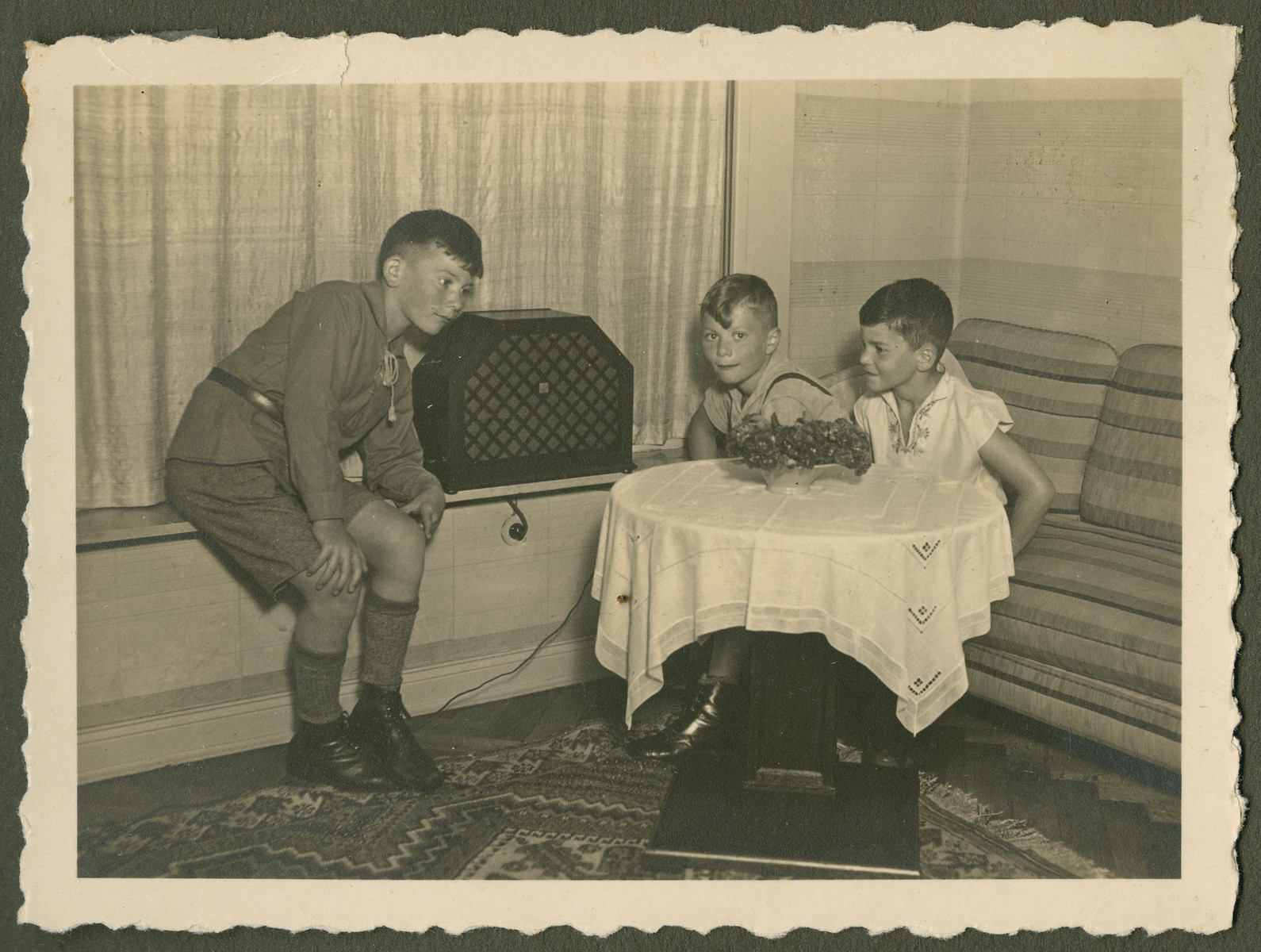 "Page from a photo album documenting one day in the life of the Gans brothers, Carl, Manfred and Theo.  This page is entitled ""Radio hour."""