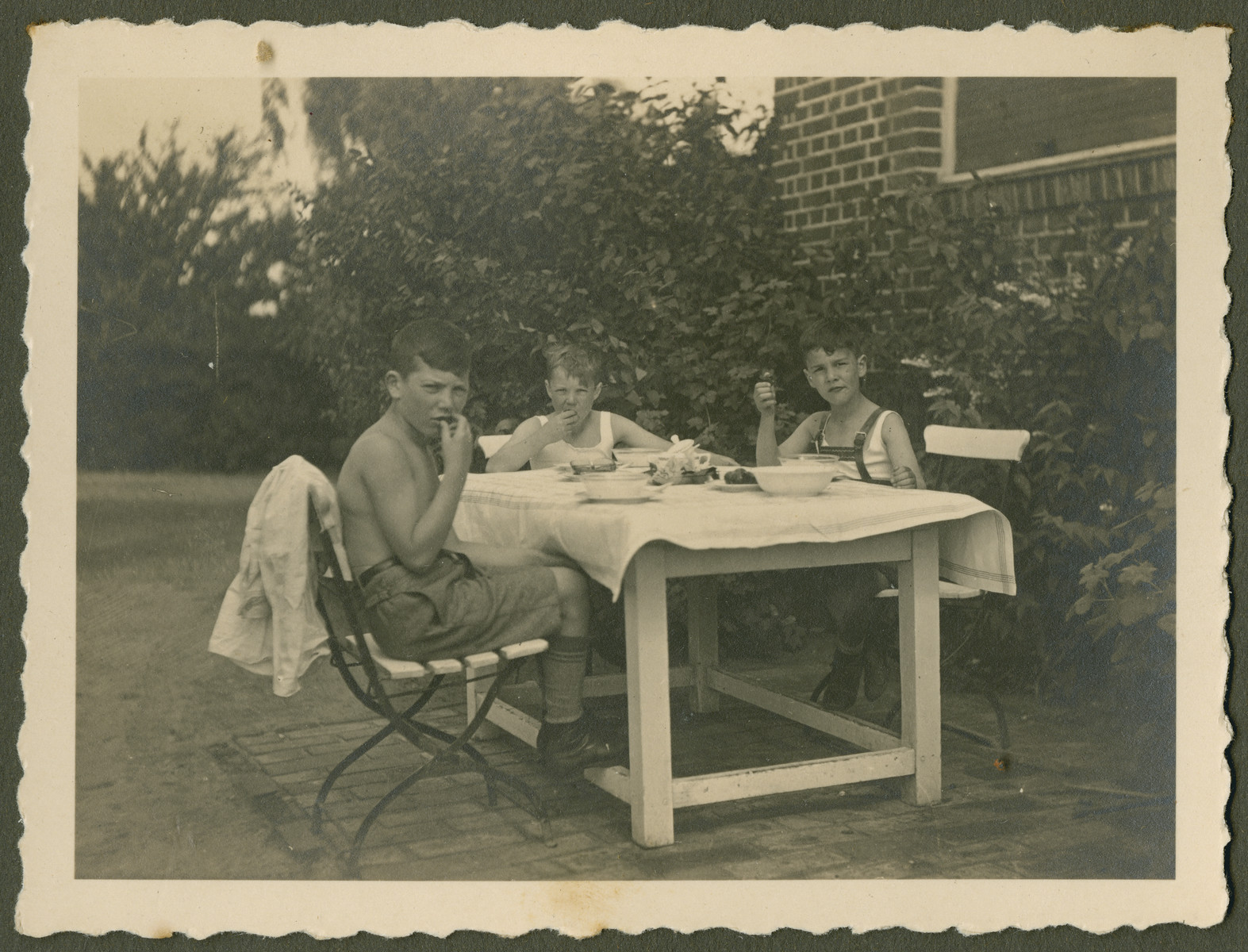 "Page from a photo album documenting one day in the life of the Gans brothers, Carl, Manfred and Theo.  The original caption reads: ""Feierabend"" (closing time)."