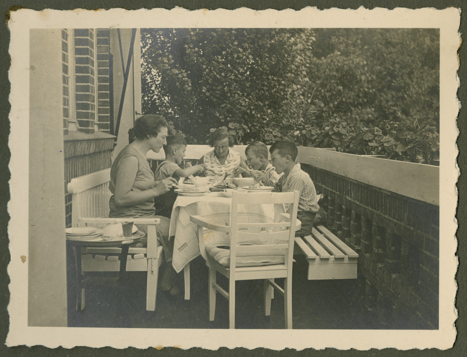 "Page from a photo album documenting one day in the life of the Gans brothers, Carl, Manfred and Theo.  This page is entitled ""Eat nicely, please."""