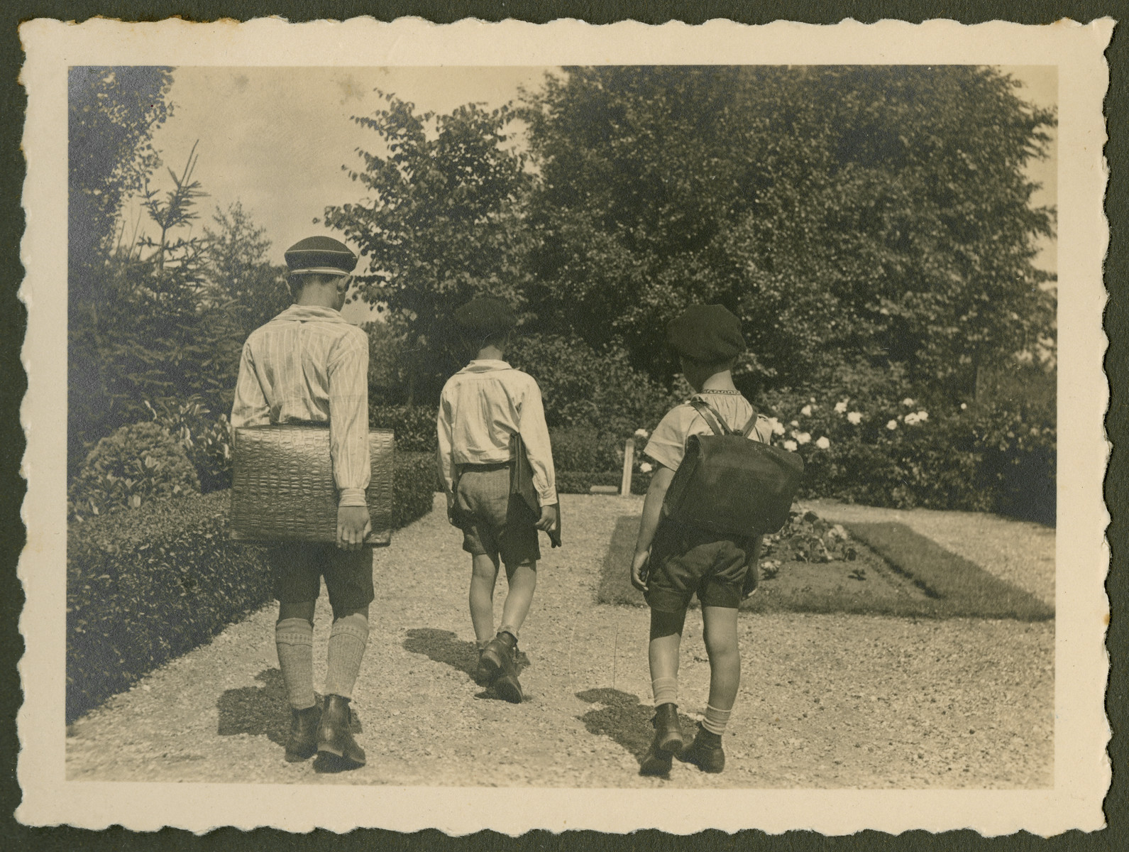 Page from a photo album documenting one day in the life of the Gans brothers, Carl, Manfred and Theo.  This page is entitled on the Kamf.