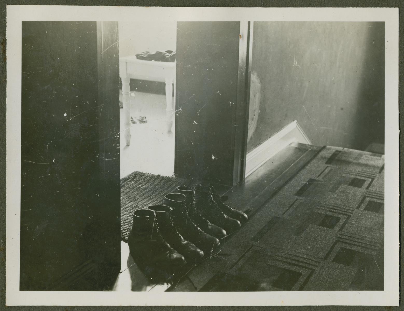 """Page from a photo album documenting one day in the life of the Gans brothers, Carl, Manfred and Theo.  The original caption in Hebrew reads """"Neilah"""" the closing prayers."""