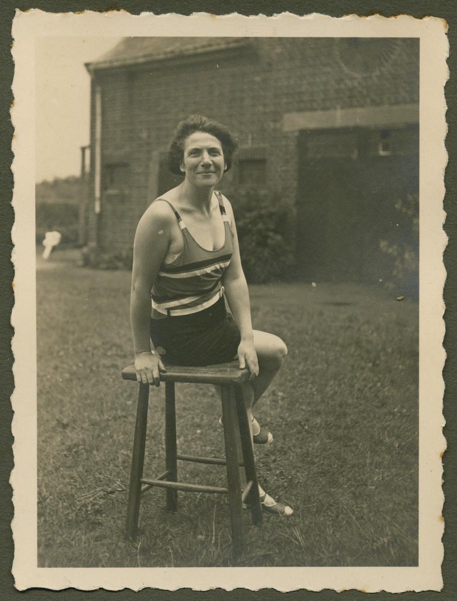 """Else Fraenkel Gans sits outside in her bathing suit.  The original caption reads: """"Der Stolz, der deutschen Flotte"""" (the pride of the German fleet)"""