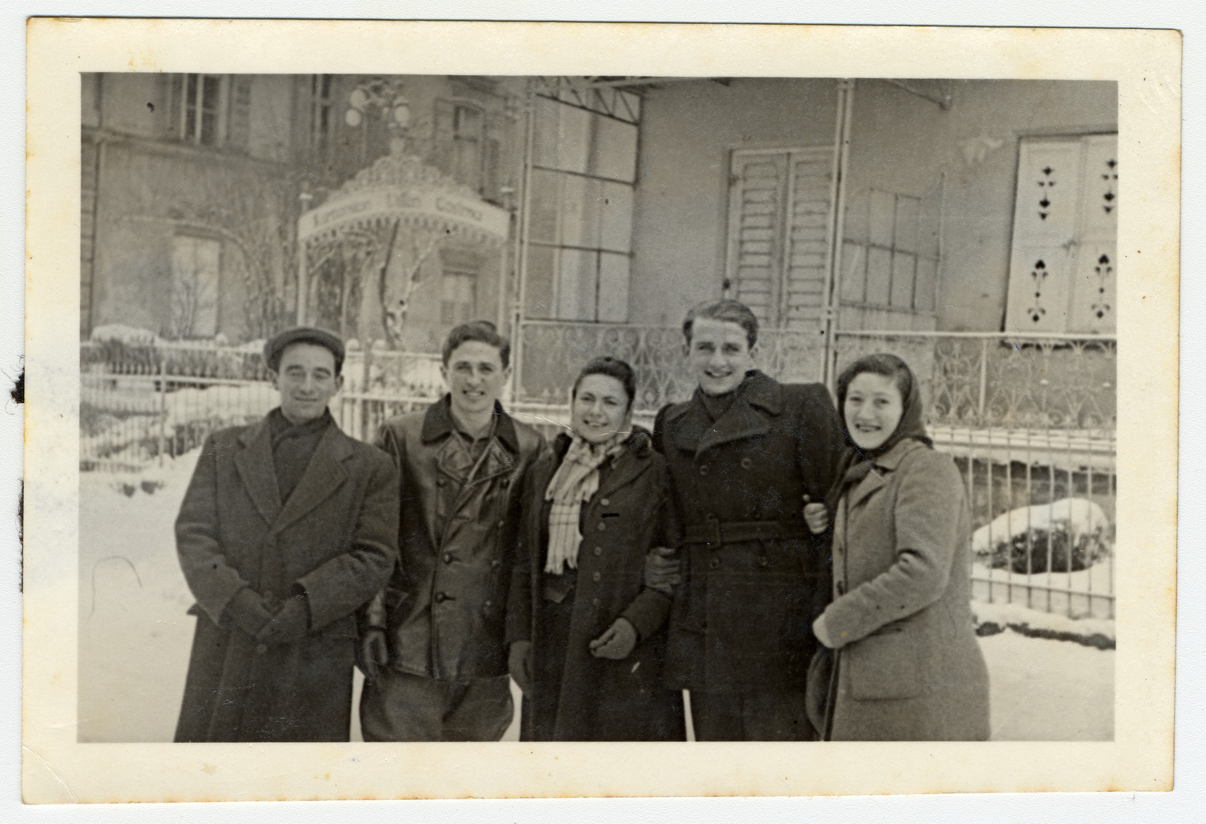 A group of young DPs gather outside in the snow at the Eschwege displaced persons' camp.