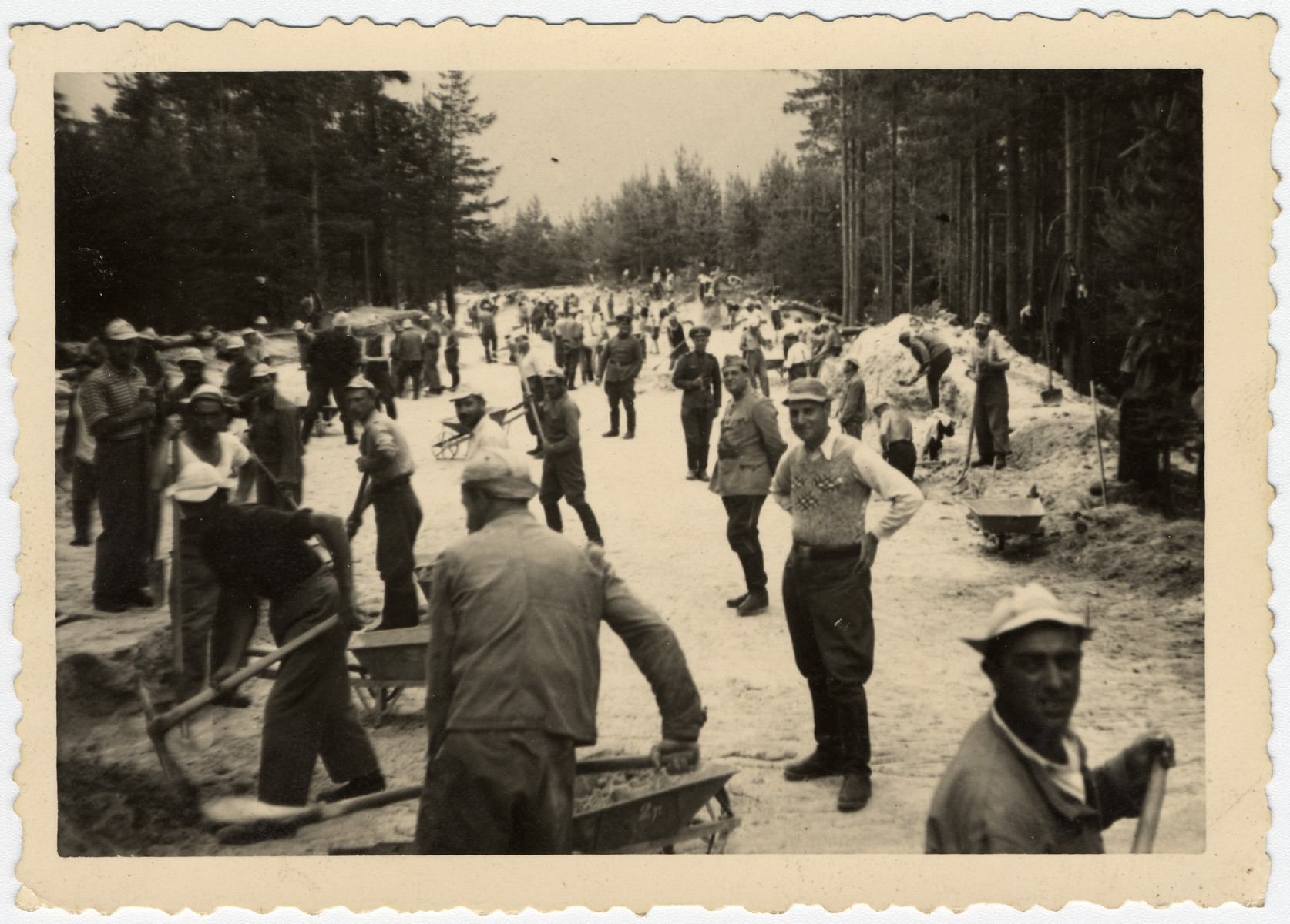 Bulgarian Jews dig a road in a forced labor brigade.