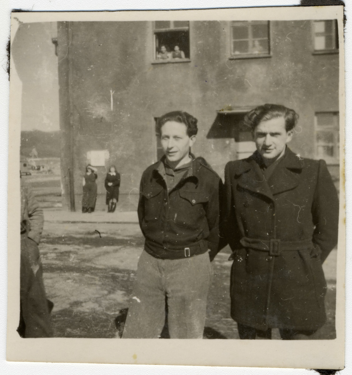 Willy Bogler (right) and a friend pose in front of the entrance to their home at the kibbutz hachshara in Eschwege.