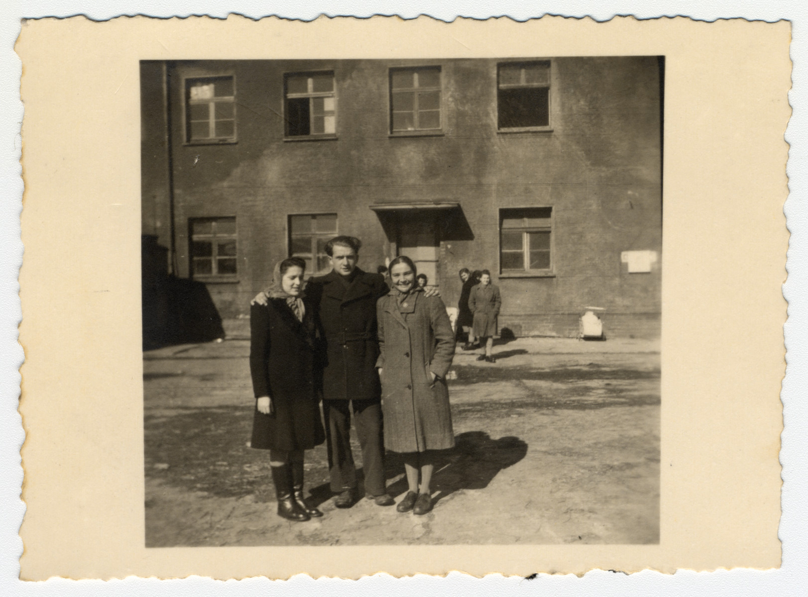 Willy and Ora Bogler and another woman pose in front of the entrance to their home at the kibbutz hachshara in Eschwege.