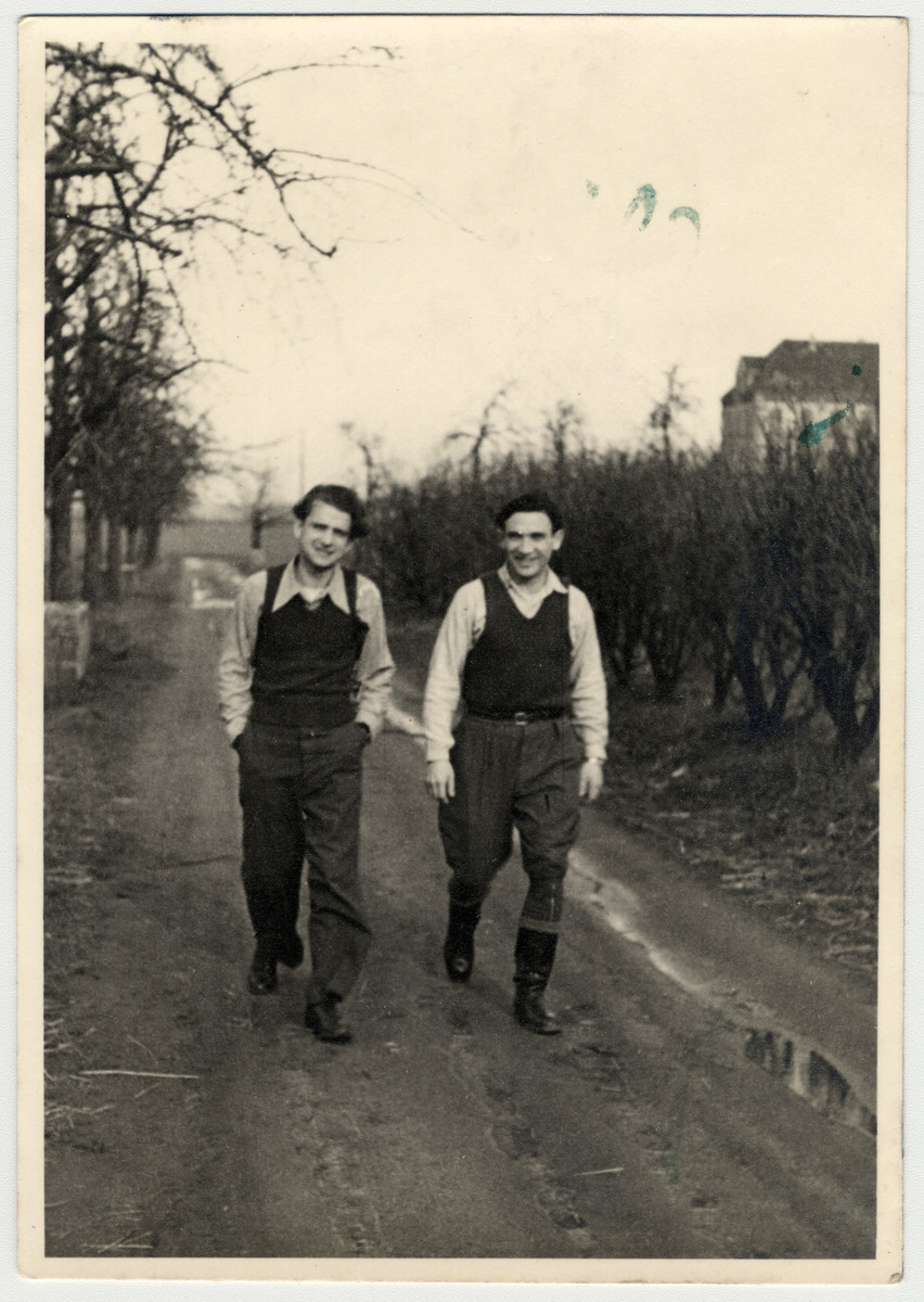 Willy Bogler and a friend walk down a road at the Eschwege displaced persons' camp.