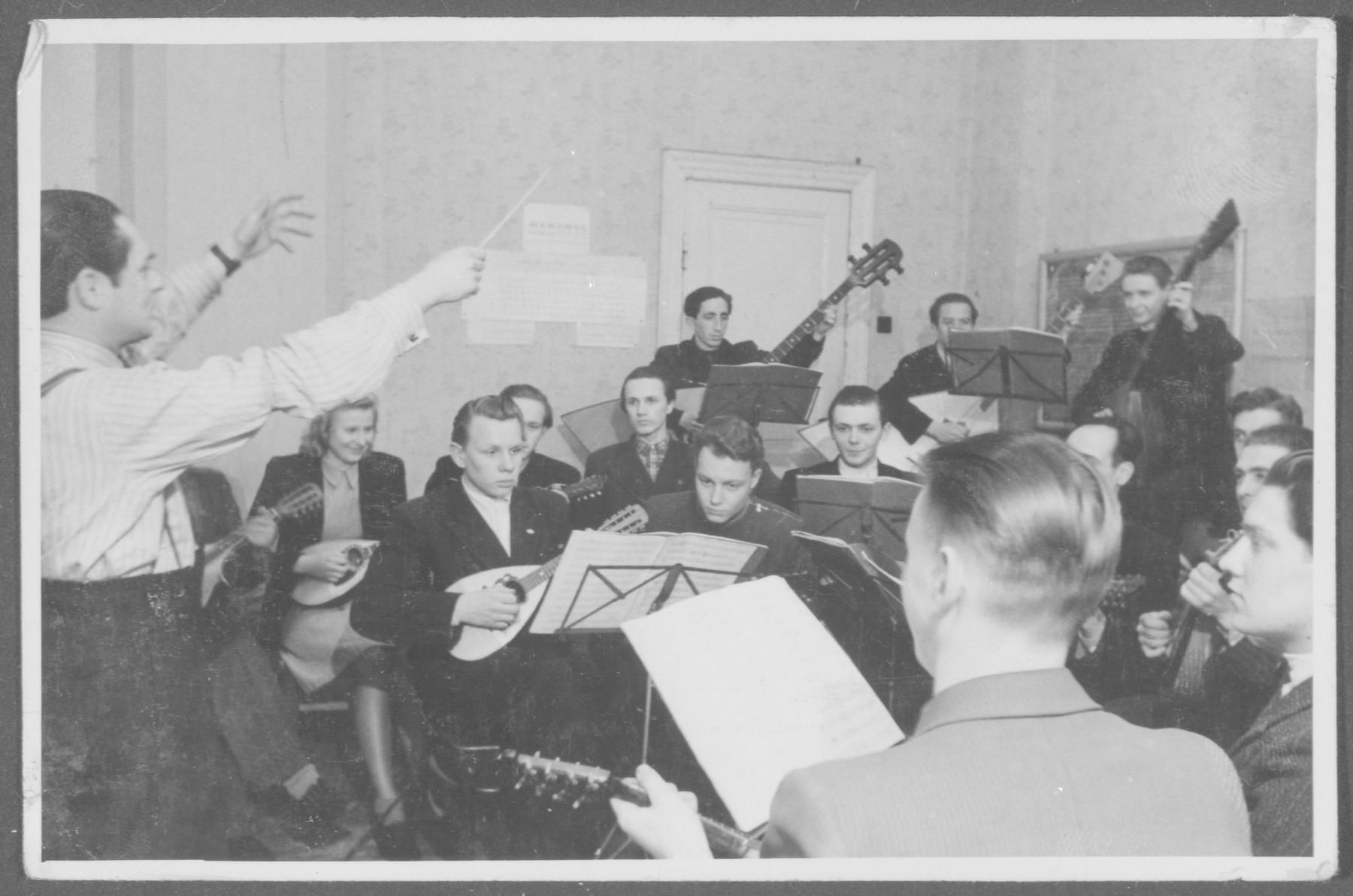 Elja Heifecs conducts a Jewish mandolin orchestra in Riga, Latvia.