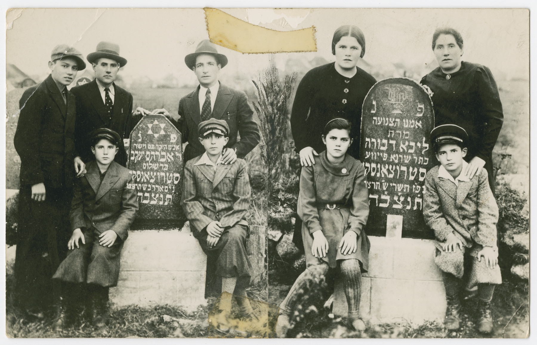 The  Struczanski family gathers by the tombstones of Avraham Yaakov and Liba Devorah  Struczanski.  Aron Struczanski seated far right and left (note mirror effect), is pictured with members of his immediate family.  Pictured are, Aron's brother Fajwel (far left), father Jona (second from left), mother Rywa (second from right), sister Rachel Struczanski (seated second from right).