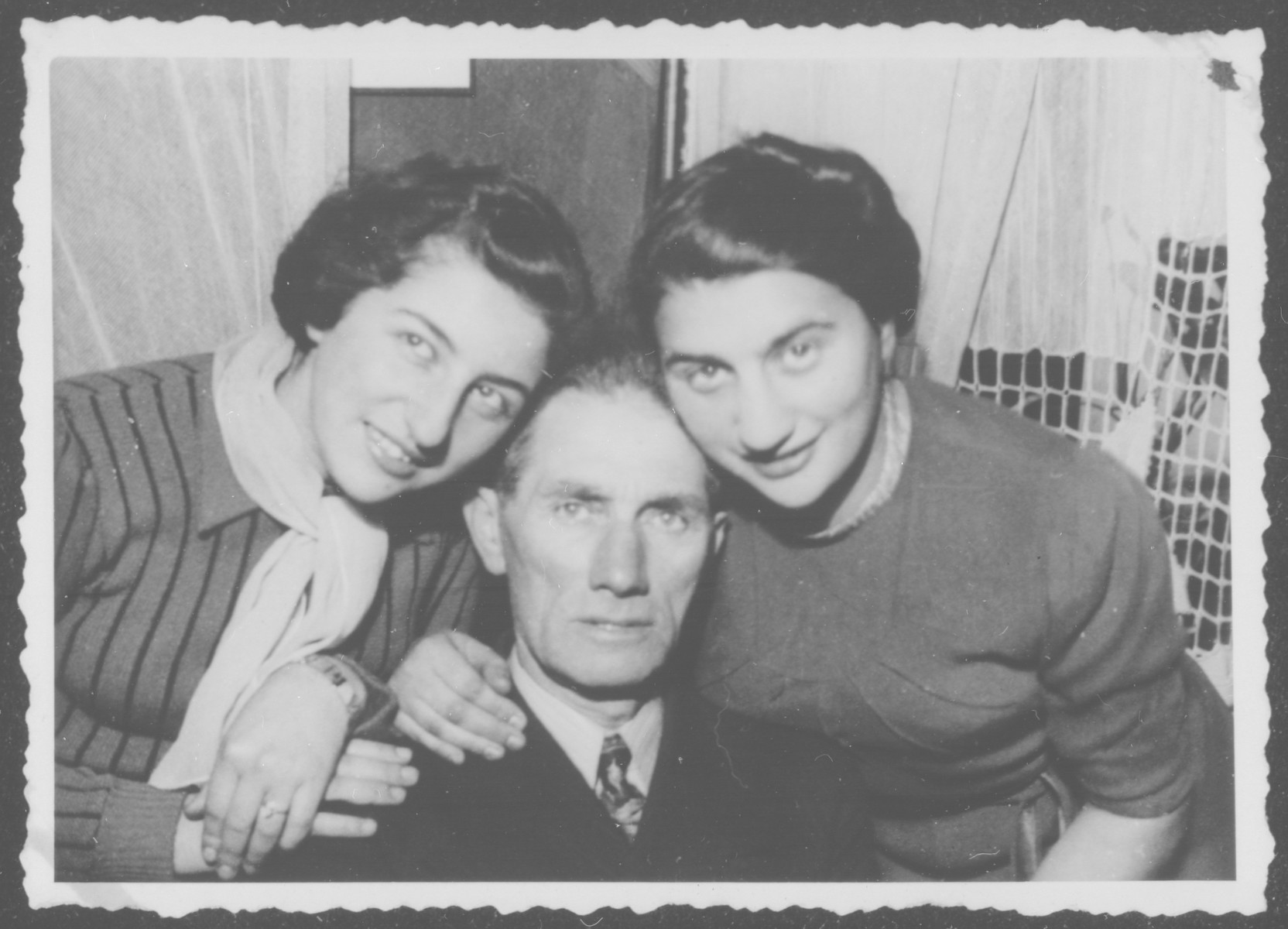 Portrait of the Grochowska family in their home in Bialystok.  Pictured are Liza, Joseph and Chaya Grochowska.