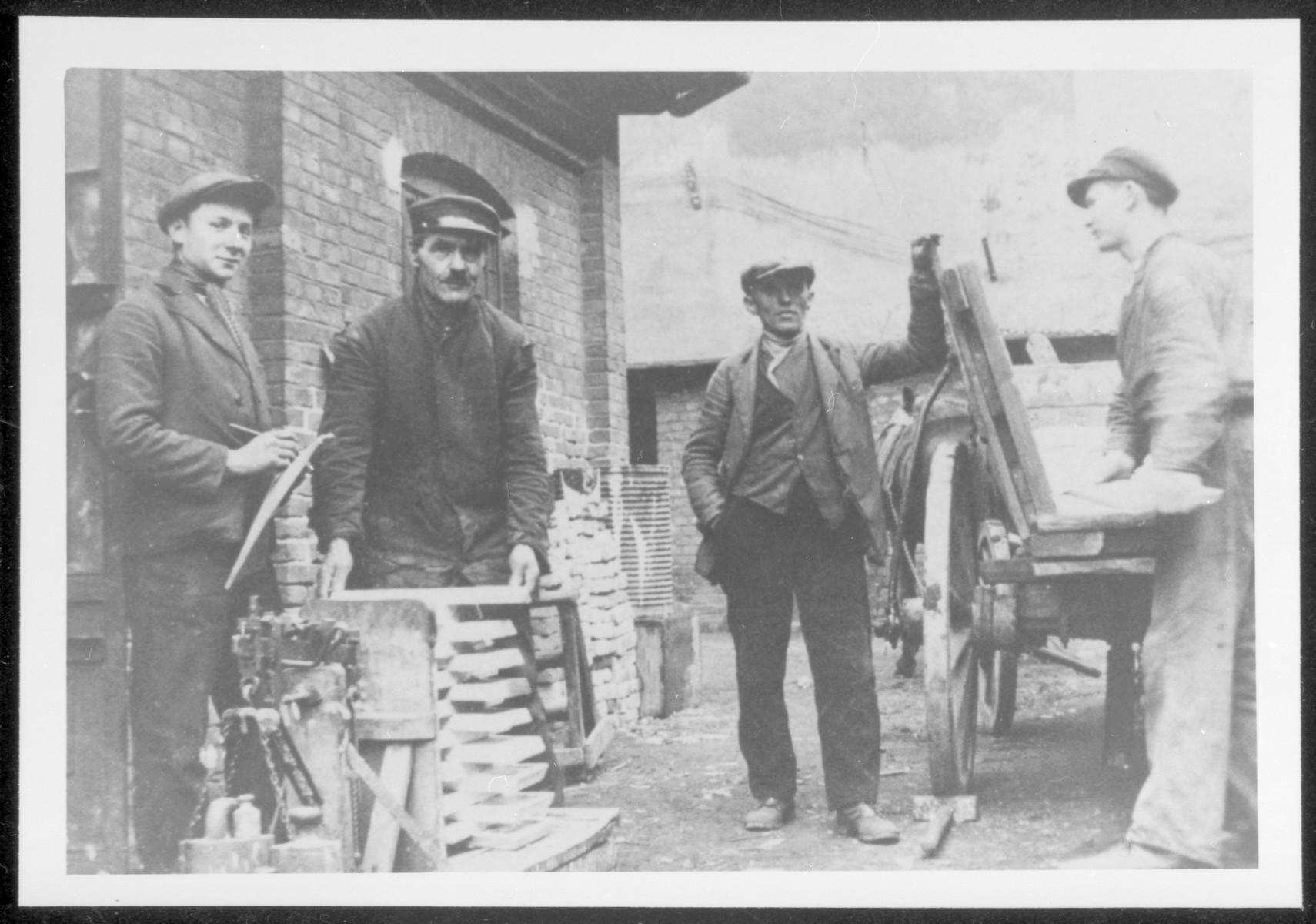 Chaim Mejer Cymbler (left) in a wood workshop in Zawierce.