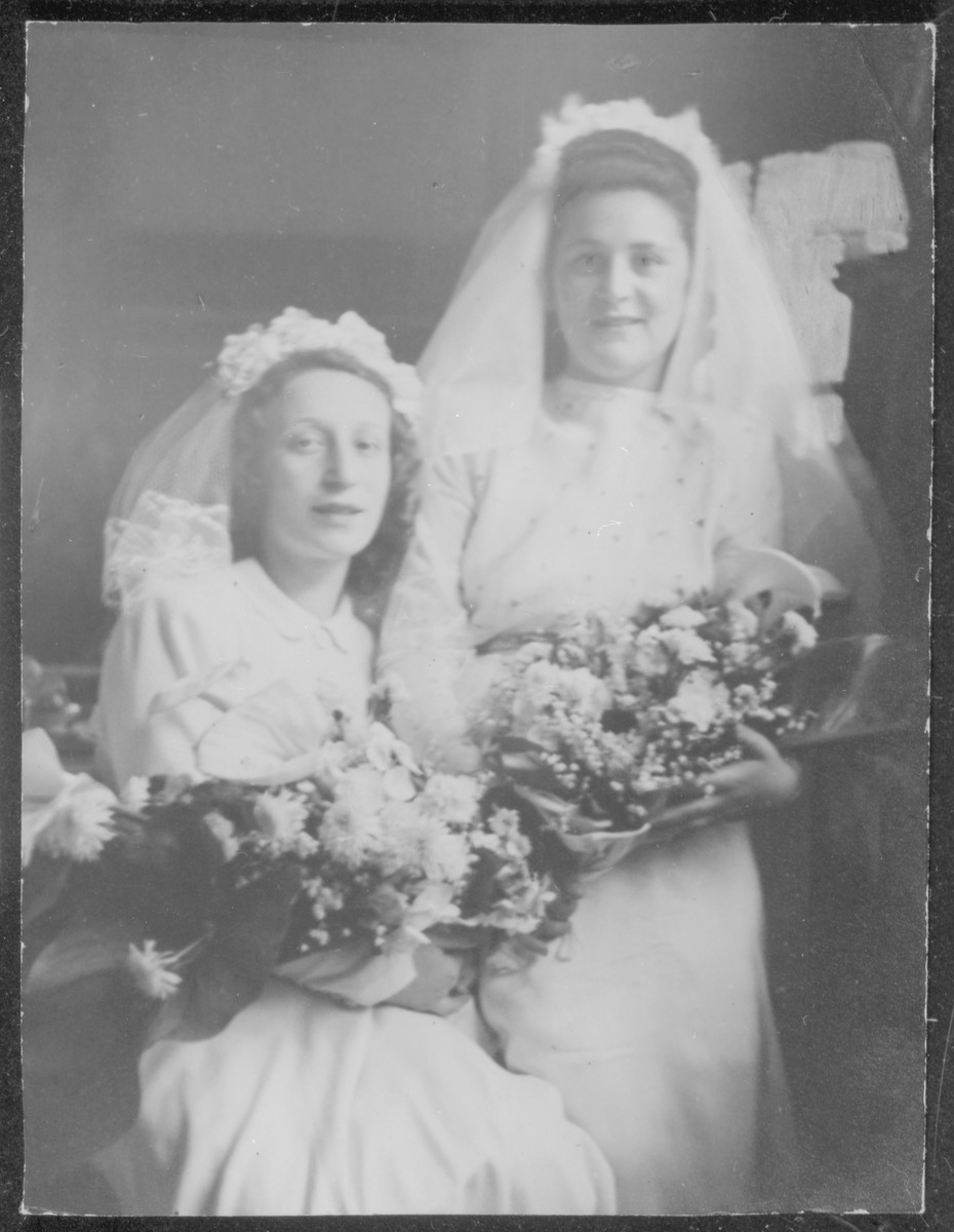 Close up portrait of two Jewish brides who were married in a double wedding ceremony that took place on Lag b'Omer, May 27, 1948 in the Prinz Albrecht Hall in Munich.    Pictured on the left is Fajgl Fiszel, and on the right, Henni Kestenberg.