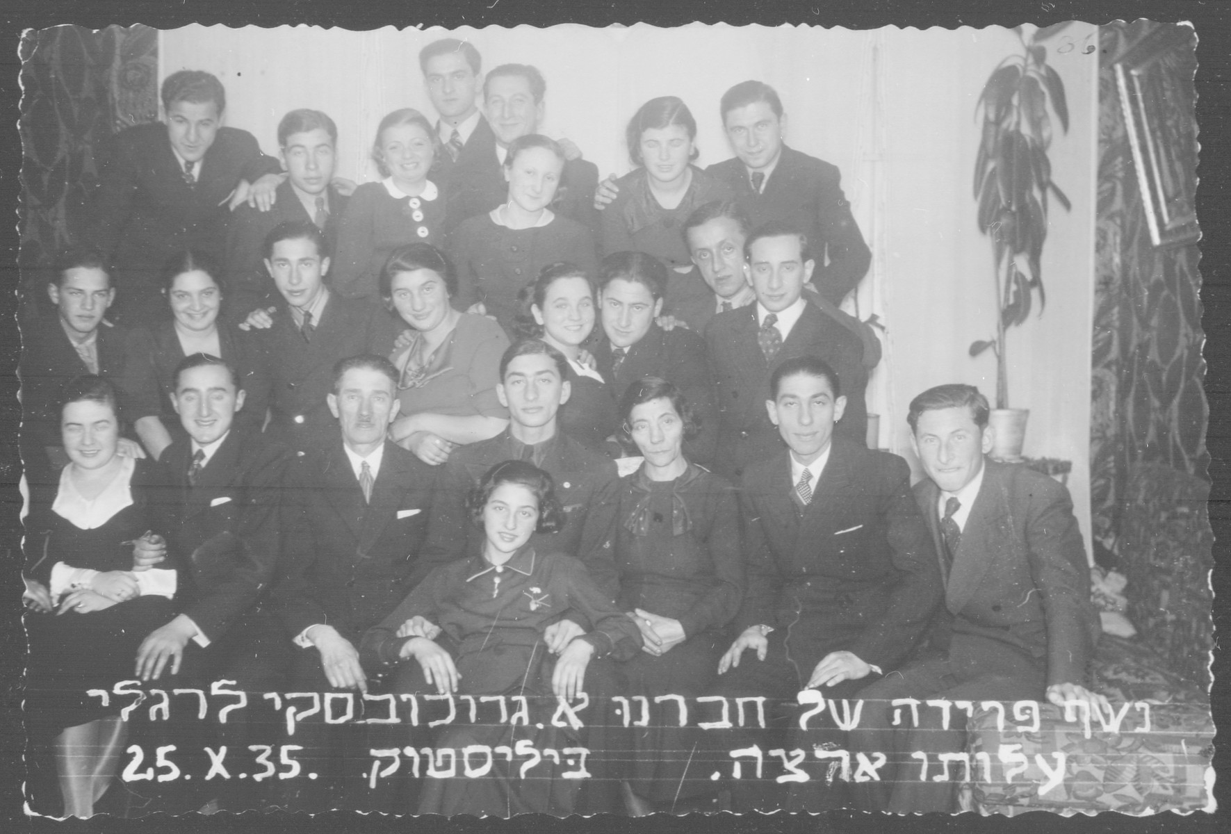 Friends gather to bid farewell to A. Grochowska (brother of the donor) before he left for Palestine.