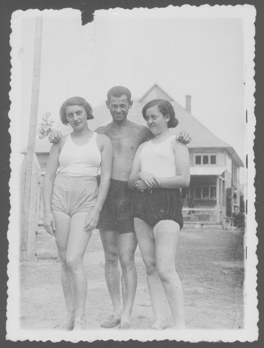 Portrait of three Jewish teenagers in a sports camp.  Liza Grochowska is standing on the left.