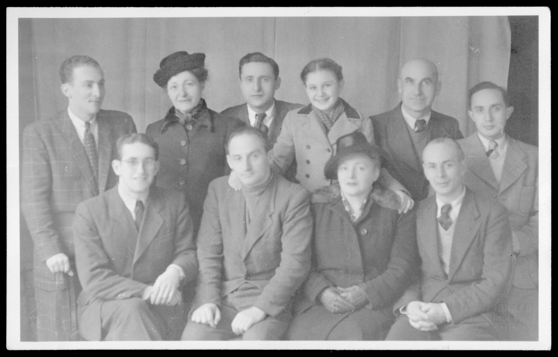 Group portrait of members of the Cultural Committee of the Fuerstenfeldbruck displaced persons' camp.   Among those pictured are many noted musicians.  Pictured seated left to right are unidentified, Jonas Turkow, Diana Blumenfeld and David Epstein.  Standing left to right are Leo Spellman , the secretary, the president of the group,  Marita Turkow-Blumenfeld, Lustig and Rosenberg.