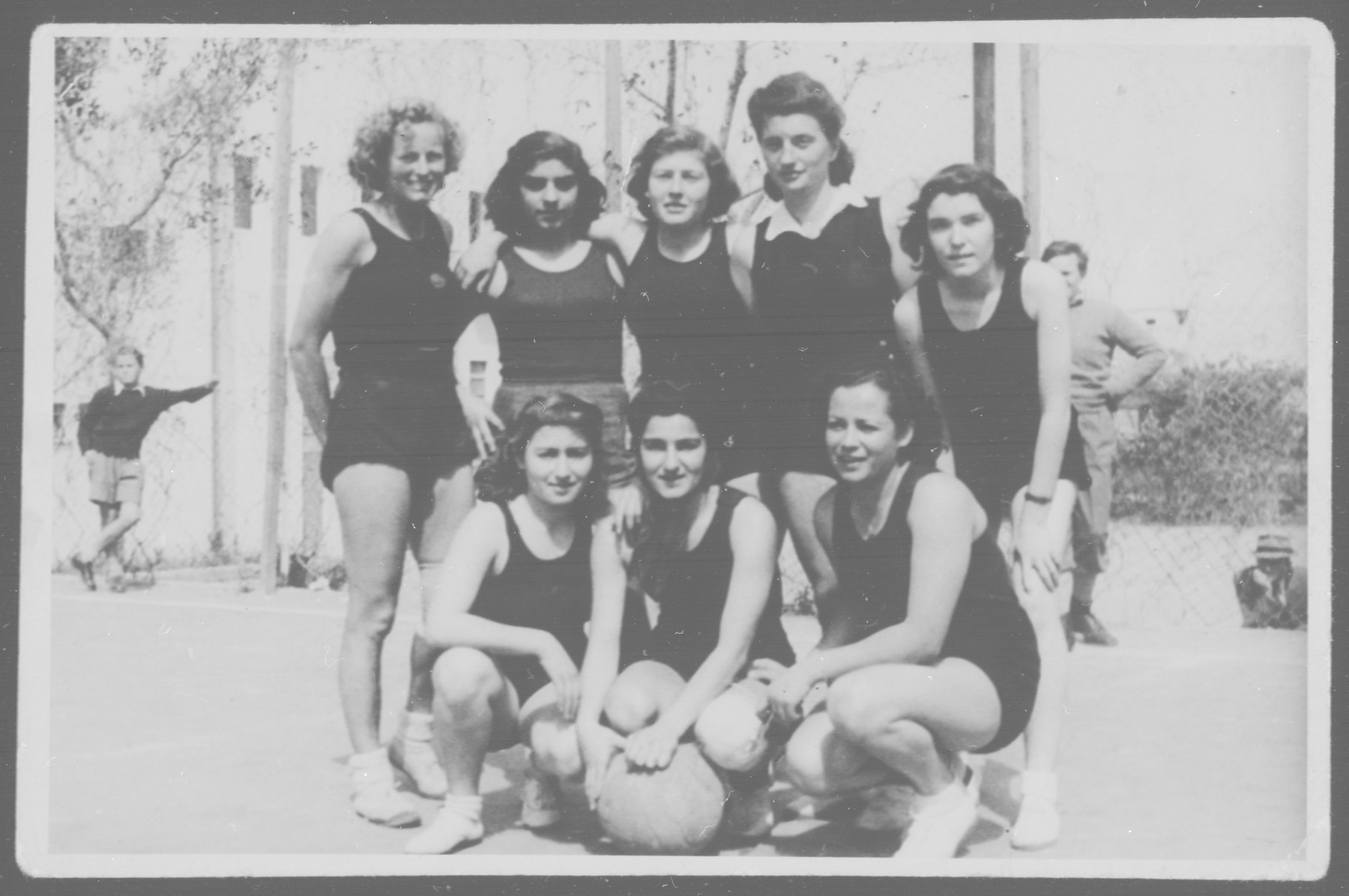 Group portrait of the Palestinian women's basketball team.   Leah Grochowska is standing second from the right.
