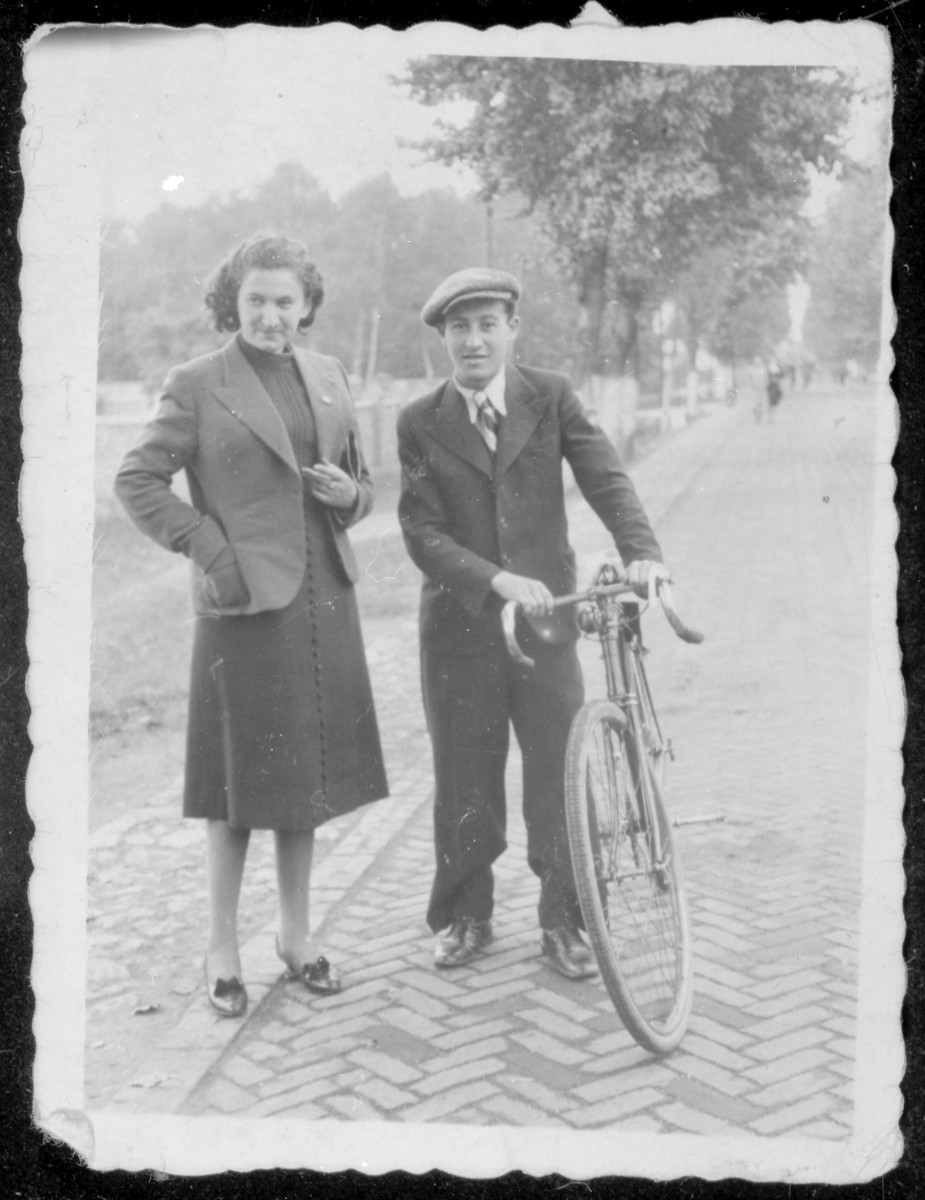 Berl Moncznik poses with his friend, Rachela Szternfeld, on a street in Niwka, Poland.
