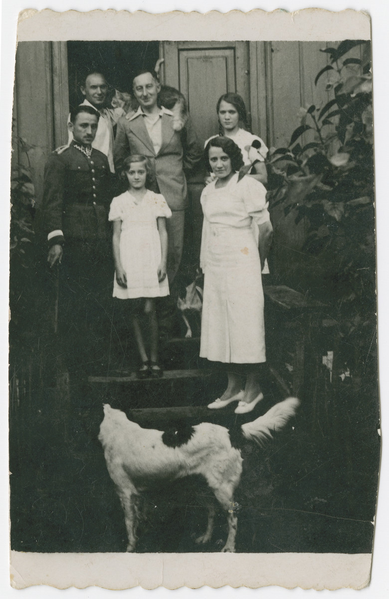 Dr. Maximilian Tendler, a doctor in Zelechow, poses among friends, with his pet cat on his shoulders