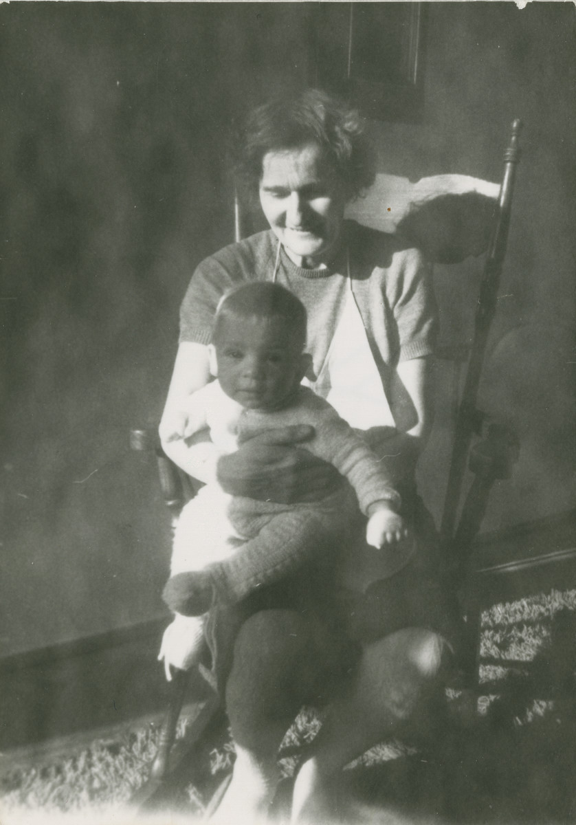 Portrait of Kazimierz Laski's older son, Marek, sitting on the lap of Mrs. Janina (born Wroblewska) Sebyla .  Mrs. Sebyla was the sister of Sofia Wiewiorowska and the mother of Alina Sebyla.