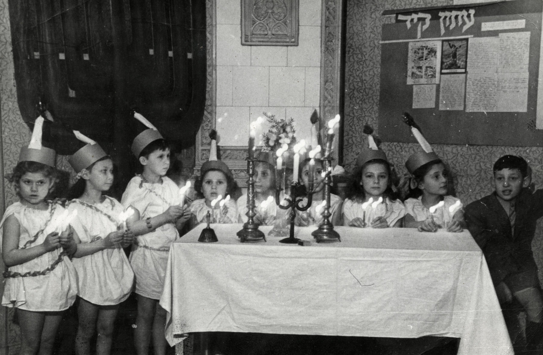 Children in the Jewish orphanage in Lodz celebrate Hannukah in costume.  Pictured left to right are Sabina, Tammy and Tamar.