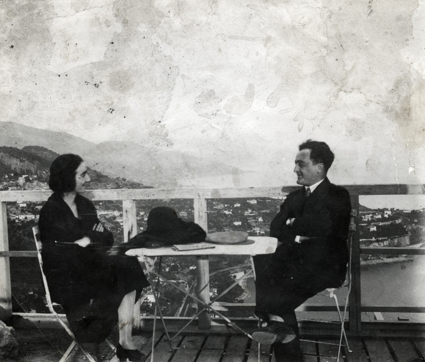 Matthieu and Alice Mueller sit by a table overlooking the lake in Geneva.