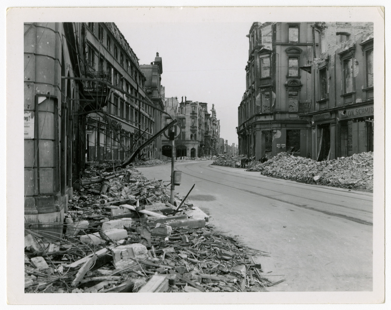 "View of a bombed-out street in Munich.  Original caption reads ""Munich, May '45."""