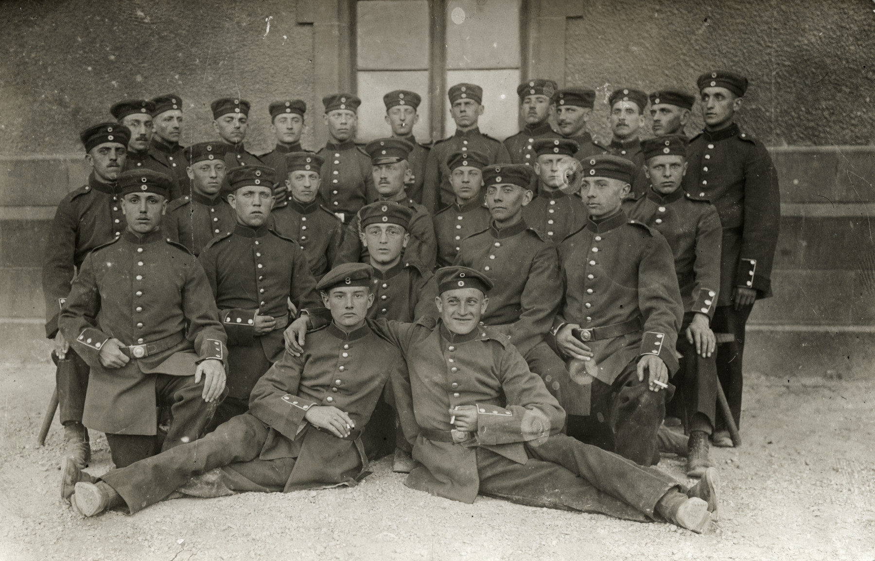 Group portrait of German soldiers.  Among those pictured is Matthieu Mueller from Alsace (a region claimed by both France and Germany).  He is pictured in the center of the second row from the bottom.