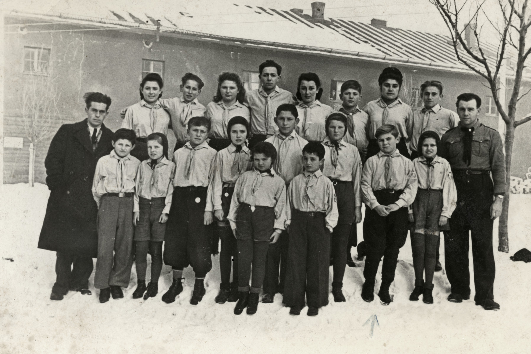 Zionist scouts stand in formation in the Bad Reichenhall displaced persons' camp.  Ziomek Hammer is standing in the first long row, second from the right.