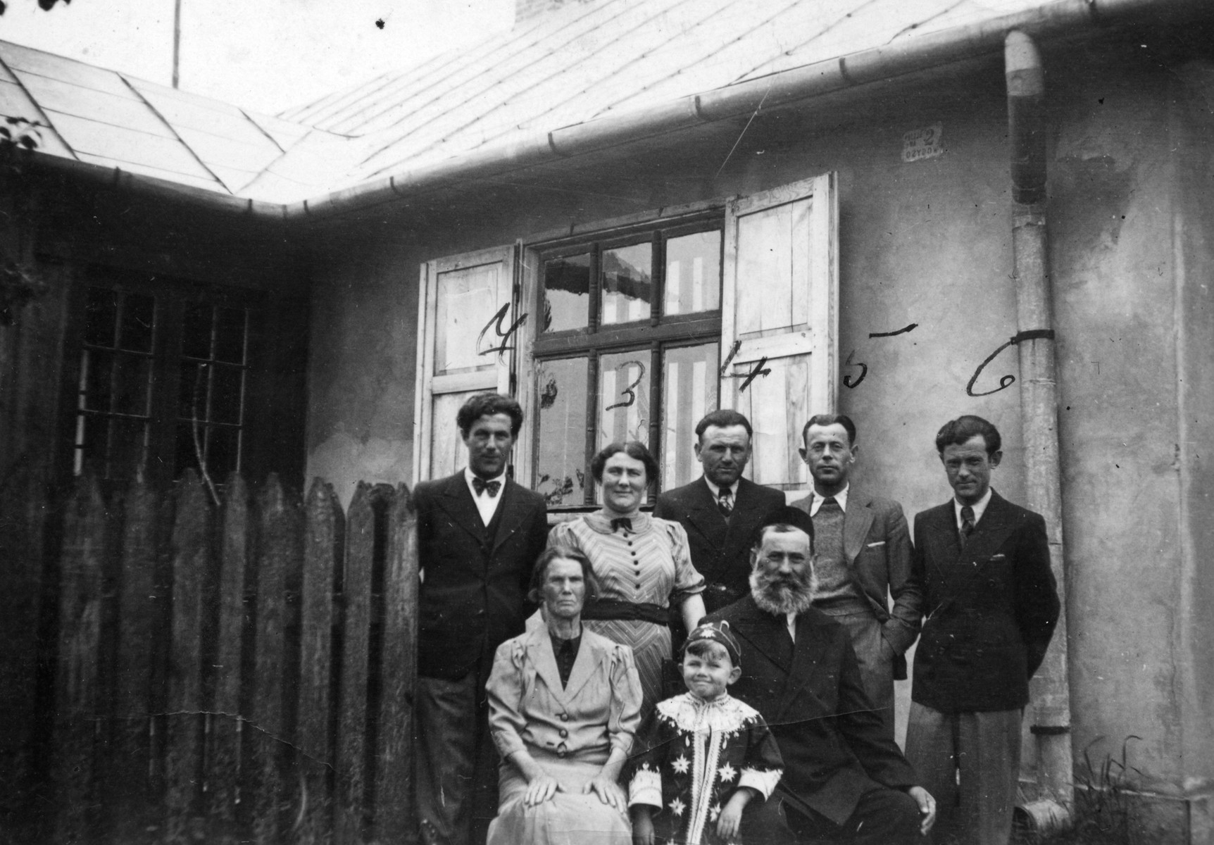 The Temple family gathers together to celebrate Purim.  From left to right are Ziomek's grandmother, Ziomek Hammer and his grandfather Moshe Lev Temple.  Standing are Gershon Temple, Lola Hammer, Heinrich Hammer, Aryeh Temple and Herman Temple.
