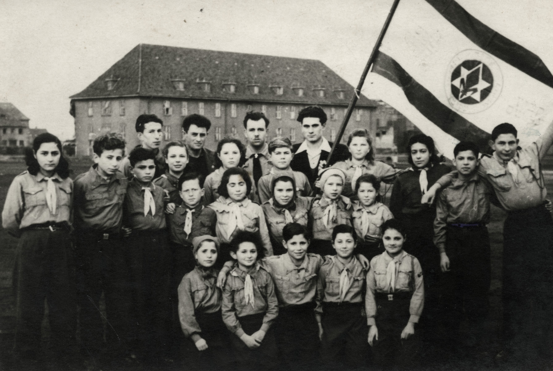 Group portrait of members of the Nitzanim group of the Zionist youth movement, Hanoar Hatzioni.  All of the children had been on the Exodus and had been sent back to Europe.  Ziomek Hammer (Shlomo HaMeiri) is pictured in the third row, fifth from the right.
