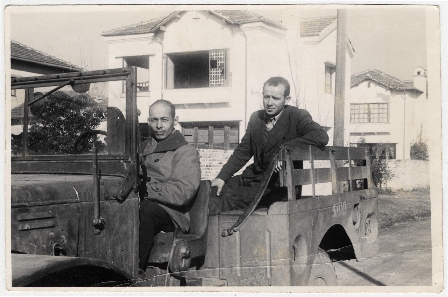 Viktor Stummer rides in the back of an open truck in Shanghai.