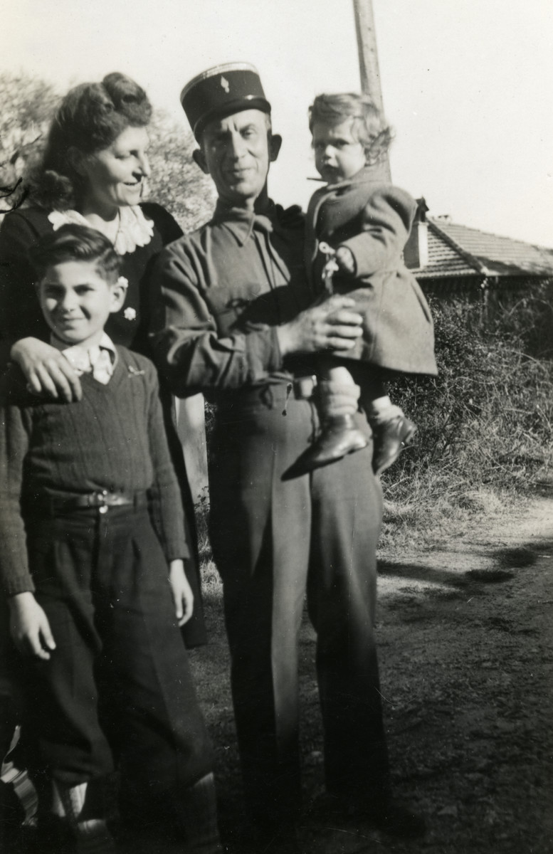 Postwar portrait of the Fainas family.  Pictured are Luba and Alexander Fainas with their sons Georges and Josie.  Alexander Fainas is serving as a lieutenant in the French Army working on de-mining in the southern France.