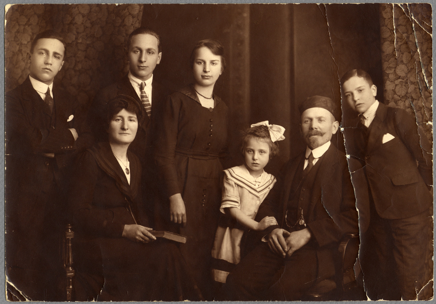 Studio portrait of an Austrian Jewish family.  Pictured from left to right are Rudolph, Mathilde (seated), Emil, Hilda, Isabella (Bella), Joseph, and Richard Wiener.