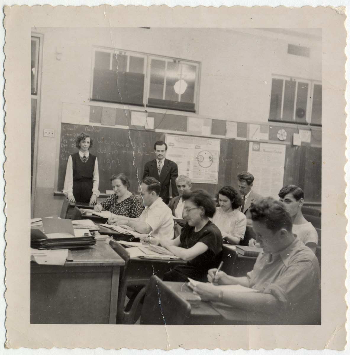 Group portrait of students in an English language class for Deaf immigrants, taught by Alice McVan, a Gallaudet alumna.  Among those pictured are Alice McVan (standing, far left); and (seated left to right) Hilda Wiener Rattner, Richard Wiener, Doris Fedrid, and Fred Fedrid.