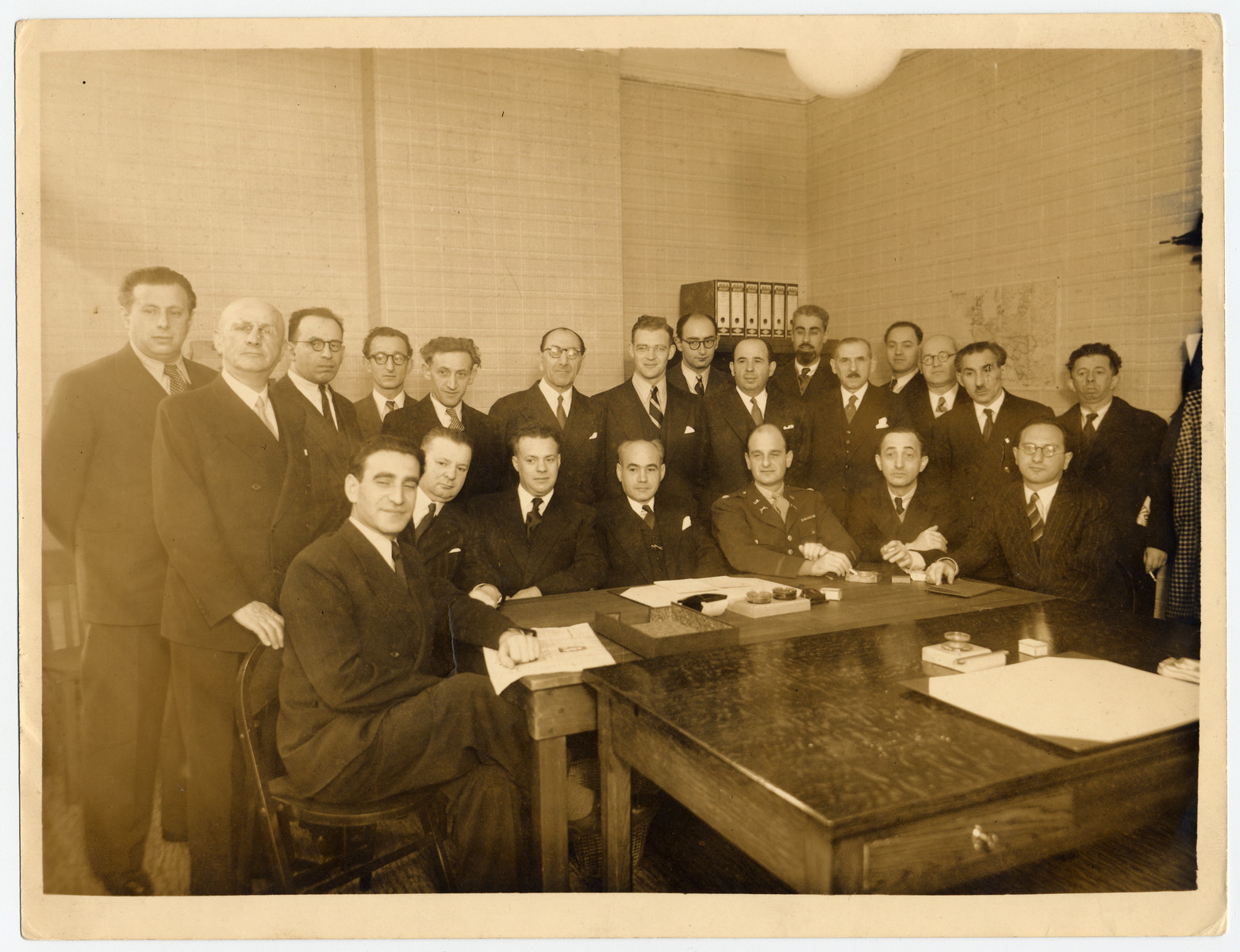 Members of the Belgian Jewish resistance meet with members of the Joint Distribution Committee after the war.  Chaim Perelman is seated in the front row on the right.  Abusz Werber is in the front row on the left.  Fucks is seated third from the left.  Aaron Dorf is standing fifth from the left and Israel Tabakman is standing second from the right.