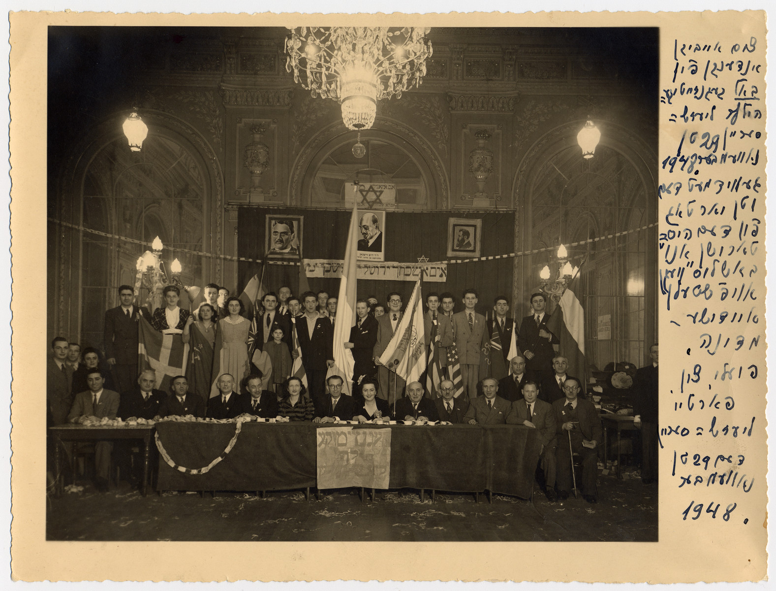 Meeting of the left-wing Zionist movement, Poale Zion, in Liege Belgium gathers to celebrate the first anniversary of the U.N. vote partitioning Palestine and granting a Jewish state.  Fela Perelman is seated in the front row center.