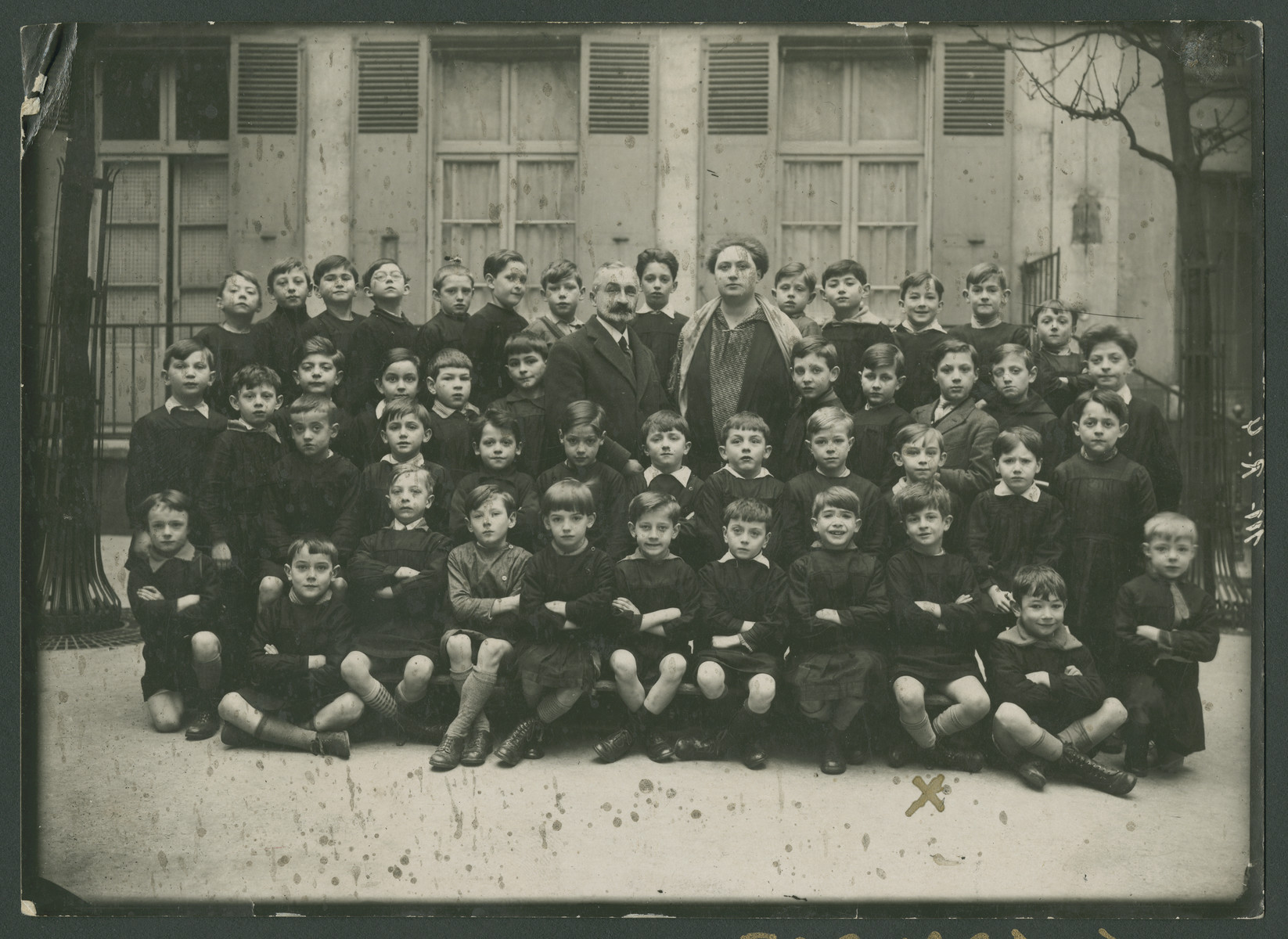 Group portrait of school boys in an elementary school in Joinville-le-Pont outside of Paris.  Edouard Arditti is pictured in the first row, thrid from the right.