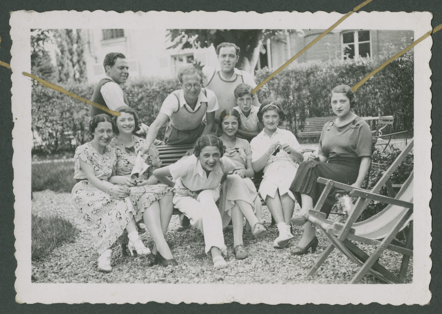 Friends of the Arditti family relax in a garden.  Yolanda is pictured second from the left.  Elsa is pictured on the far right  Edouard Arditti is the younger boy in the center.