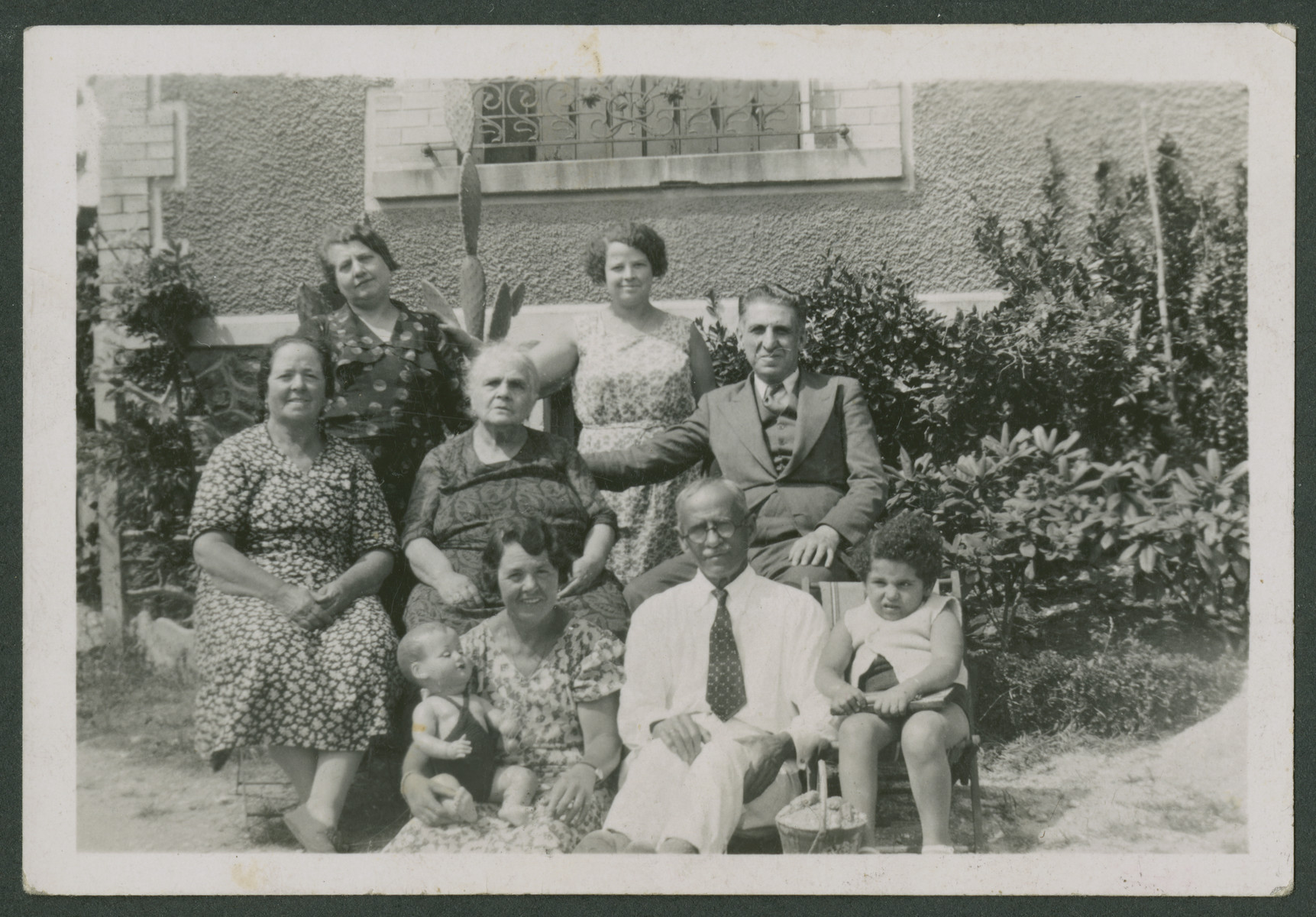 The Arditti family sits outside their home.  Jacques Arditti's grandmother (maden name Jaffe) is seated in the center.  His mother is standing on the left and his father is seated on the right.