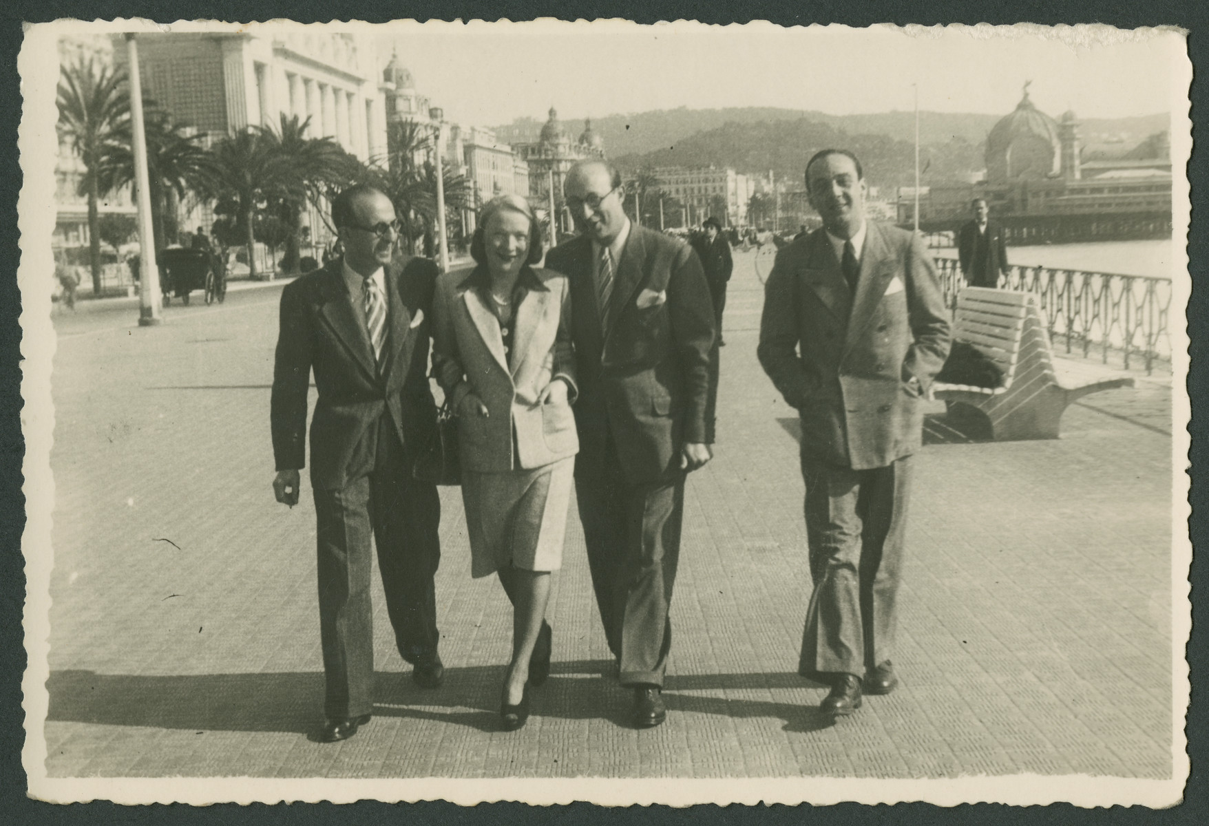 A group of friends walk down the English Promenade in Nice.    Jacques Arditti is third from the left.  Jacques Robert Behar is on the far right.