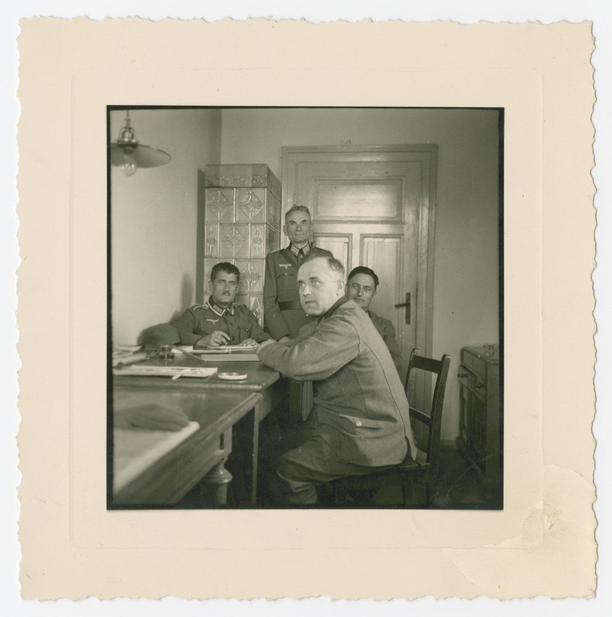 German soldiers sit in a newly established office in Oswiecim days less than two weeks after the start of World War II.