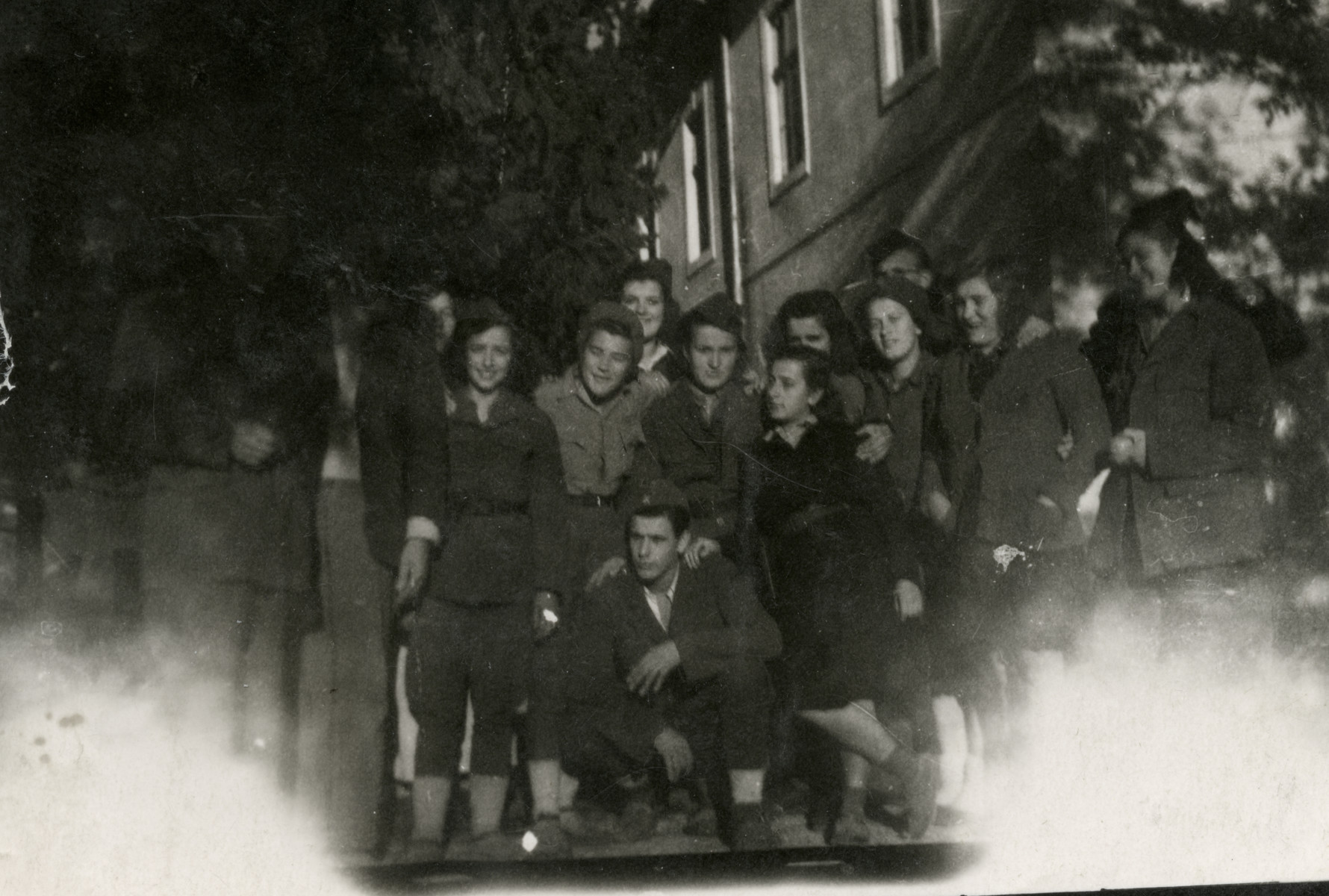 Group portrait of Jewish female partisans in Yugoslavia.  Donna Papo stands in the front with her legs crossed.