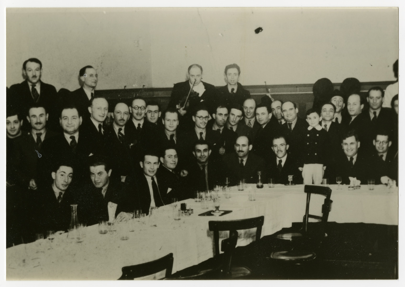 Hungarian Jewish men who had served together in the Sarospatak labor camp gather for a meeting at the Hotel Schalkhaz in Kosice.  Alex Gellman is pictured in the middle row, second from the left.