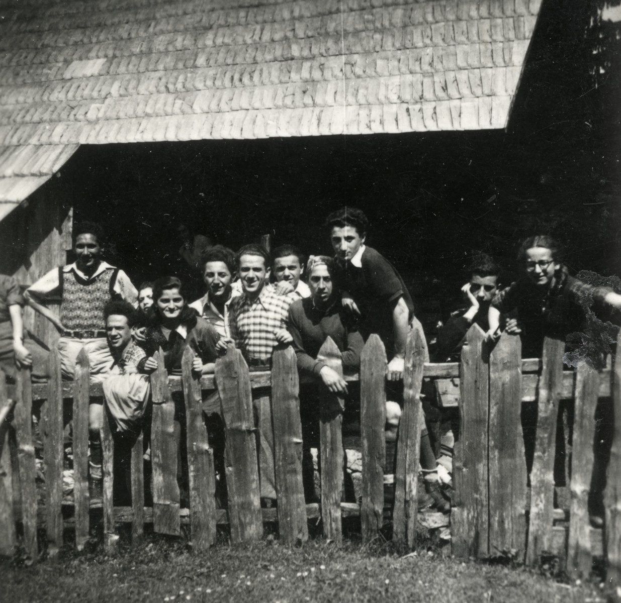 Members of the Zionist youth movement Hashomer Htatzair.pose next to a fence in Yugoslavia.    Donna Papo is pictured on the far right.