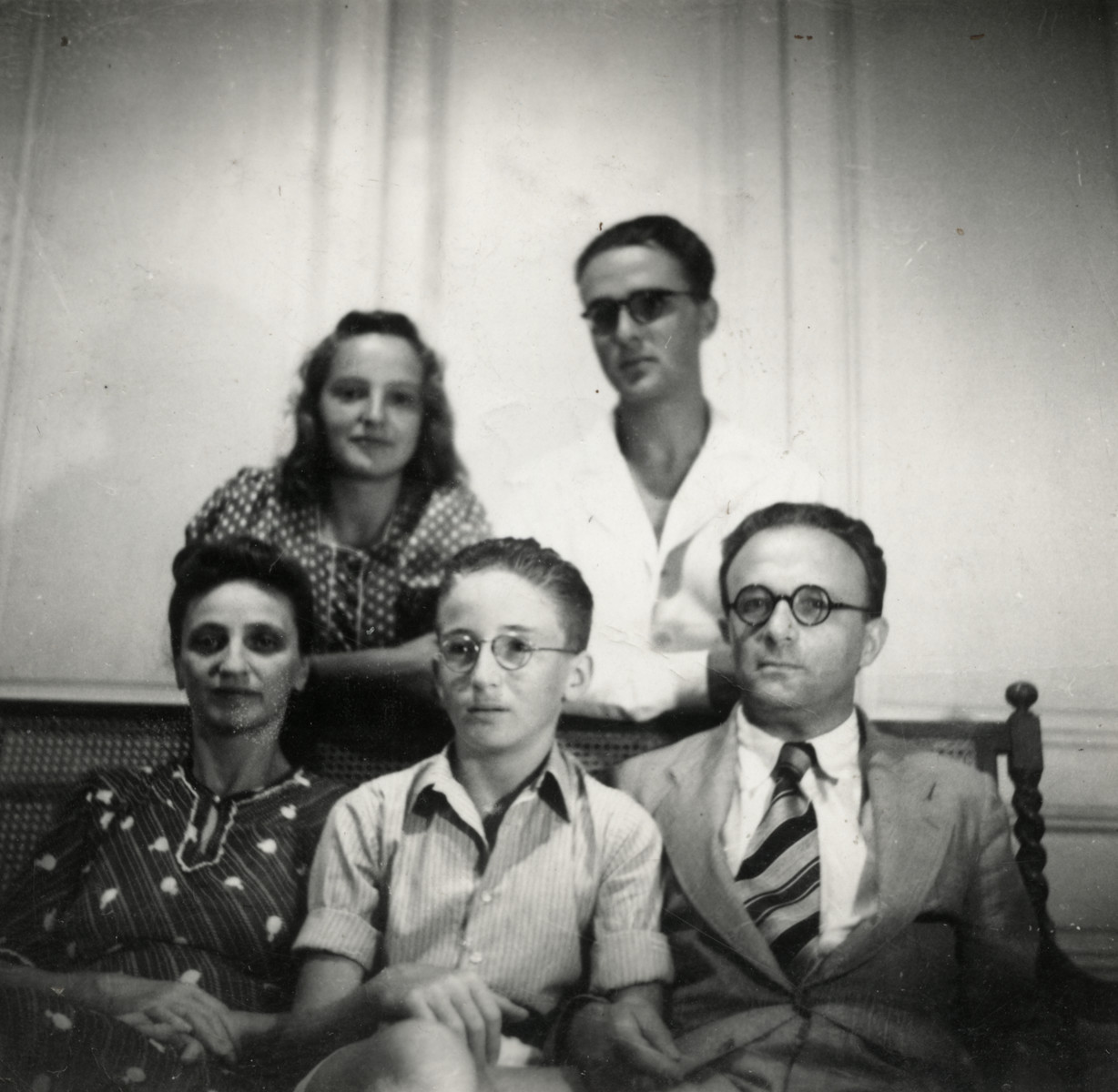 Portrait of the Beretras family in their home in Tunis.    Pictured sitting from left to right are Renee, Emanuel and Leopold Beretras.  Standing left to right are Anni and Luigi.