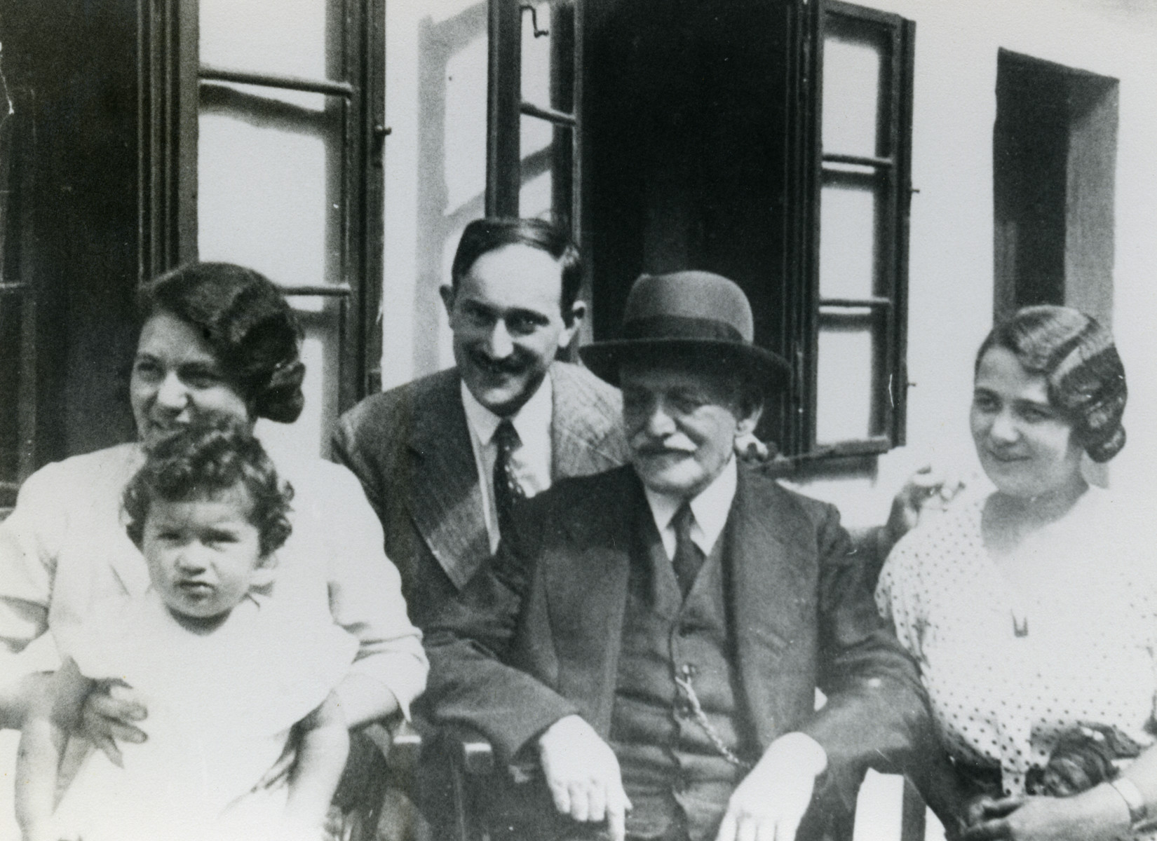 Group portrait of the Krausz and Jeiteles family.  From left to right: Dr. Lydie Krausz holding her daughter Helene Doris, Dr. Gajza Krausz, Dr. Isidor Jeiteles, one of Lydie's sisters.