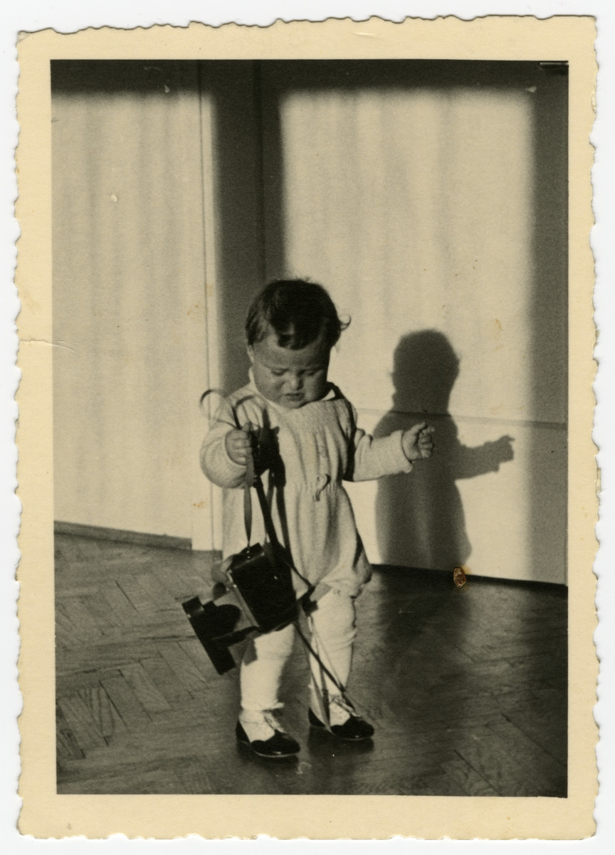 Lea Herlinger holds her father's Leica camera.